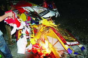 Burn votive papers on Vu Lan festival
